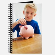 Child with a piggy bank Journal