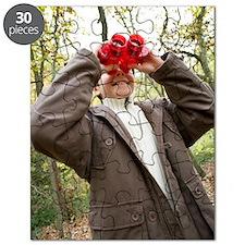 Boy using binoculars Puzzle