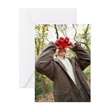 Boy using binoculars Greeting Card