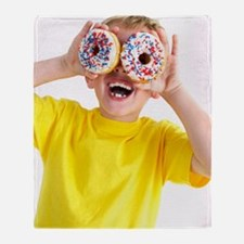 Boy playing with doughnuts Throw Blanket