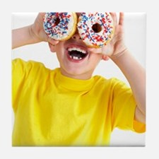Boy playing with doughnuts Tile Coaster