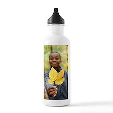 Boy holding autumn lea Water Bottle