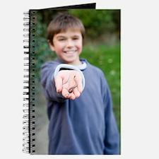 Boy holding an earthworm Journal