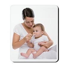 Baby taking medicine Mousepad