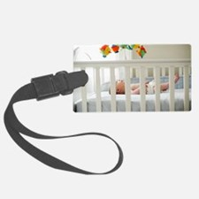 Baby boy in his cot Luggage Tag