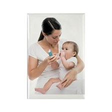 Baby using an asthma spacer Rectangle Magnet