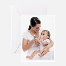 Baby using an asthma spacer Greeting Card