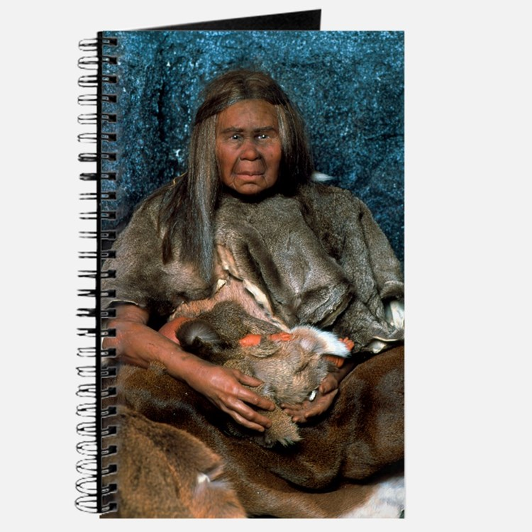 Model of a neanderthal woman holding a bab Journal