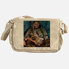 Model of a neanderthal woman holding Messenger Bag