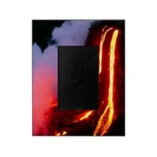 Lava flowing down cliff into the oce Picture Frame