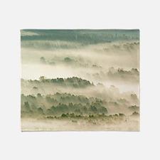 Morning mist over farmland Throw Blanket