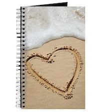 Heart-shape drawn in sand Journal