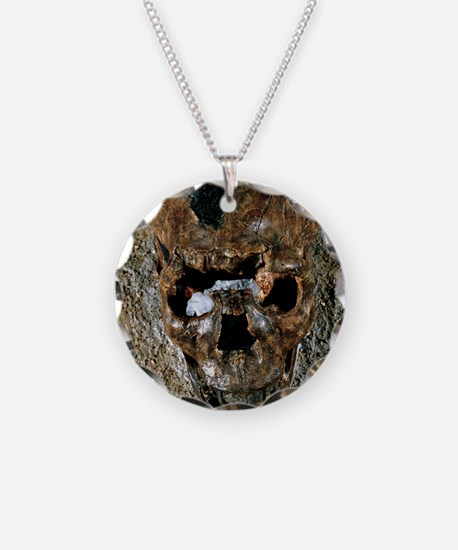 Fossilised skull of a Homo e Necklace