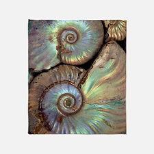 Fossilised ammonites Throw Blanket
