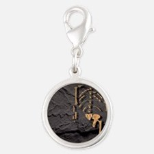 Footprints and skeleton of Luc Silver Round Charm