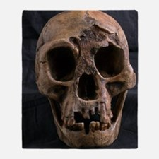 Homo floresiensis skull Throw Blanket
