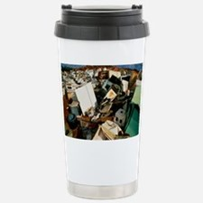 Discarded metal goods in a land Travel Mug