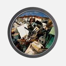 Discarded metal goods in a landfill sit Wall Clock