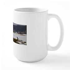 Rainbow, snow and bird Mug