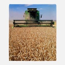 Combine harvester working in a wheat Throw Blanket