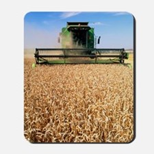 Combine harvester working in a wheat fie Mousepad