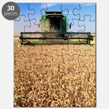 Combine harvester working in a wheat field Puzzle
