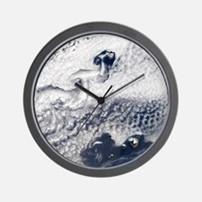 Clouds disrupted by islands Wall Clock