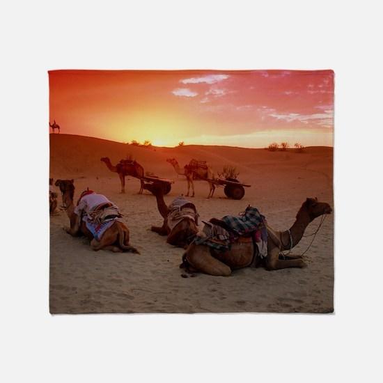 Camel caravan settling down for the  Throw Blanket