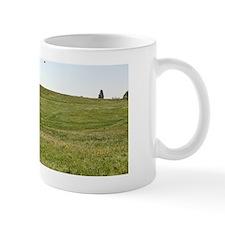 Kite flyer on hill Mug