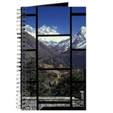 Looking out of a window onto a mountain vi Journal