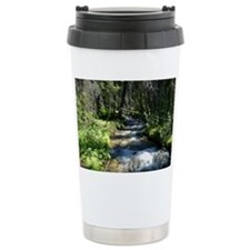 Water moving through forest Travel Mug
