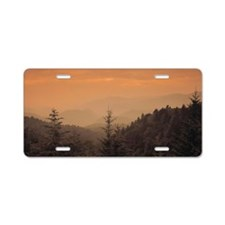 Hazy mountains with evergre Aluminum License Plate