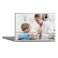Dentist with boy in surgery Laptop Skins