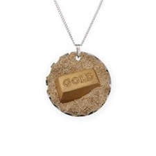 Gold bar in the sand. Necklace