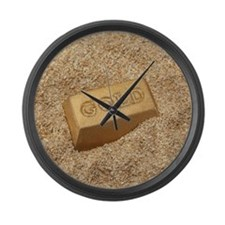 Gold bar in the sand. Large Wall Clock