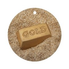 Gold bar in the sand. Round Ornament
