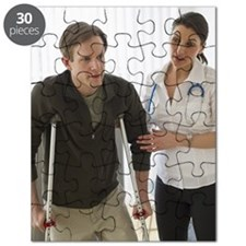 Man walking on crutches in doctor's office Puzzle
