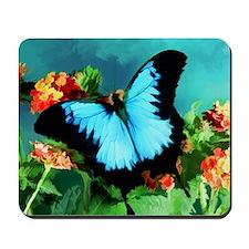 Blue Butterfly on Orange Lantana Flowers Mousepad
