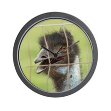 A dark colored ostrich behind a fence Wall Clock