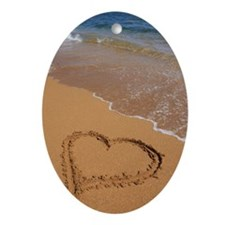 Heart drawn in red sand on beach, el Oval Ornament