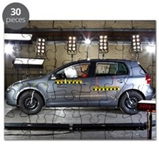 A car with a crash test dummy in a crash te Puzzle