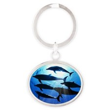 Porpoises in the Ocean with Sun Rays Oval Keychain