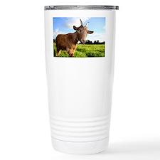 A cute farm pigmy goat smiles a Travel Mug
