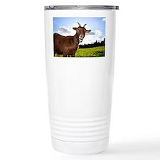 A cute farm pigmy goat pulls a  Travel Mug