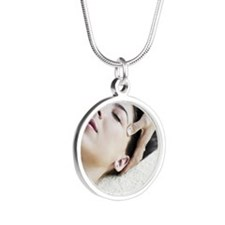 Woman Receiving Facial Silver Round Necklace