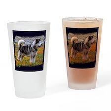 Alaskan malamute in a field of flow Drinking Glass