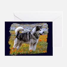 Alaskan malamute in a field of flowe Greeting Card