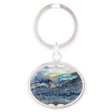 desert snowfall after the storm Oval Keychain