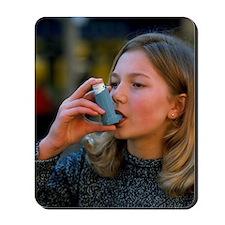 Teenager using an aerosol inhaler for as Mousepad