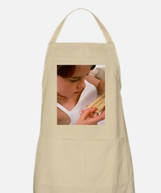 Teenage girl holding pack of contraceptive p Apron